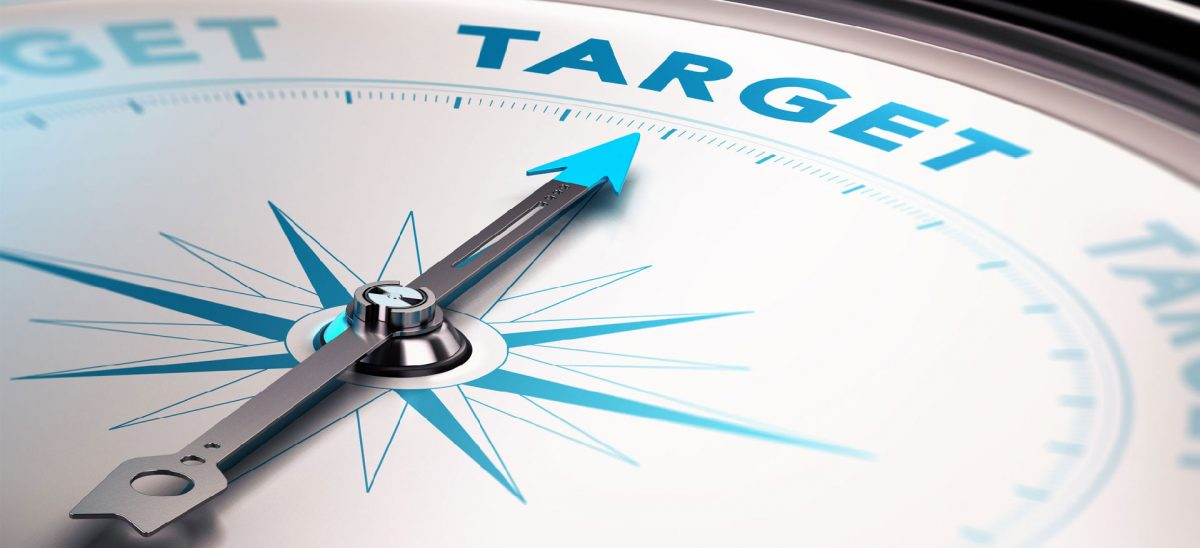 "Image of a compass pointing text saying ""target,"" reflecting targeted media"