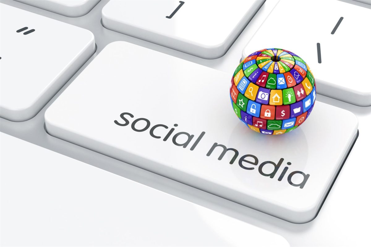 Stylized image of a keyboard with social media key and a globe representing social media engagement