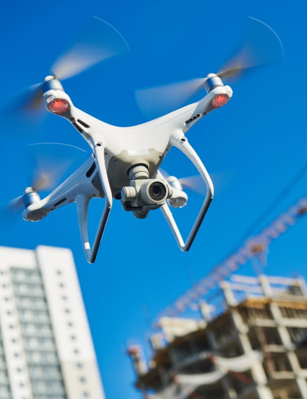 Image of an aerial drone flying over a construction site